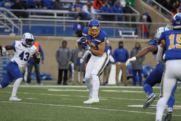 SDSU's Kal Hart (83) makes a catch over the middle during the first quarter of the Jackrabbits'matchup against the Sycamores Saturday evening at Dana J. Dykhouse Stadium in Brookings.