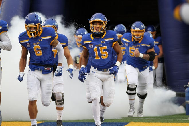 SDSU WR Cade Johnson (15) helps lead his team out of the tunnel before the SDSU Matchup against Indiana State Saturday afternoon in Brookings.