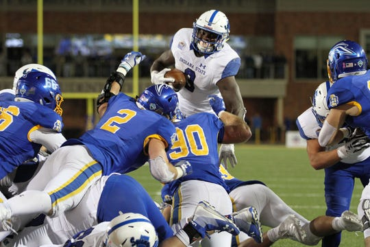 Indiana State's Ja'Quan Keys (3) gets stuffed by South Dakota State's Ryan Earith (90) on third and goal in overtime of the Jackrabbits' 54-51 win over the Sycamores Saturday evening at Dana J. Dykhouse Stadium in Brookings. This stop led to a Sycamores field goal and gave the Jackrabbits a chance to win with their touchdown.