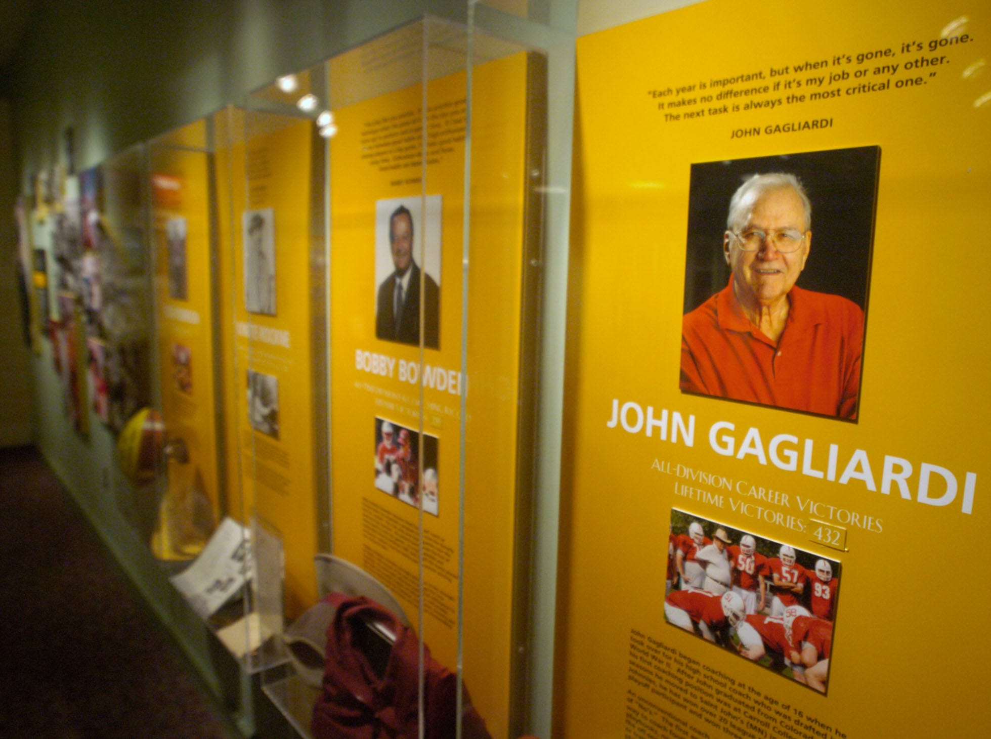 A display honoring St. John?s University head football coach John Gagliardi joins those of many other college football greats inside the College Football Hall of Fame in South Bend, Ind.
