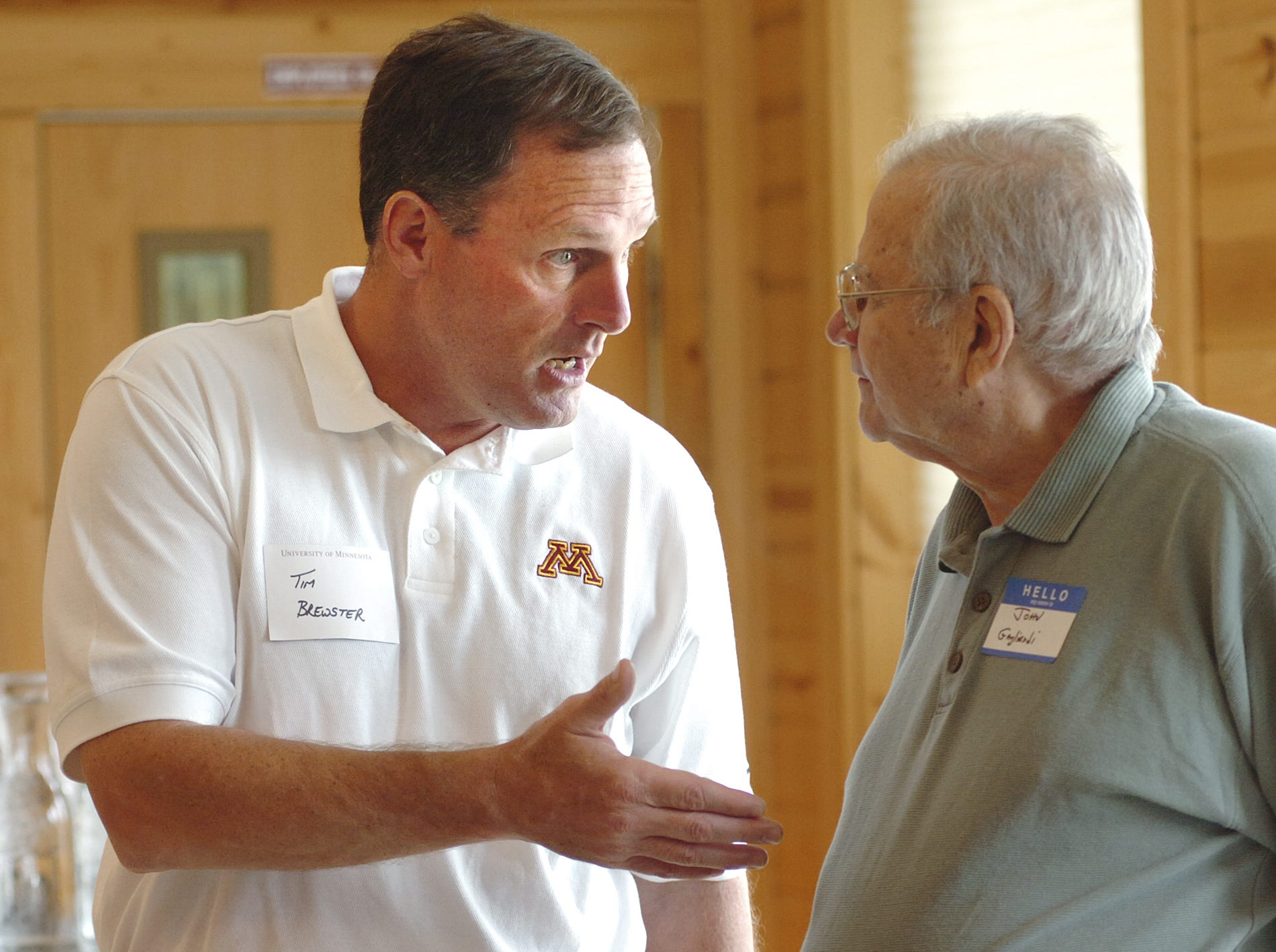 University of Minnesota head football coach Tim Brewster (left) talked shop with St. John's University coach John Gagliardi (right) before the start of the 2007 Gophers Coaches Caravan at Mulligan's Event Center in Sartell.
