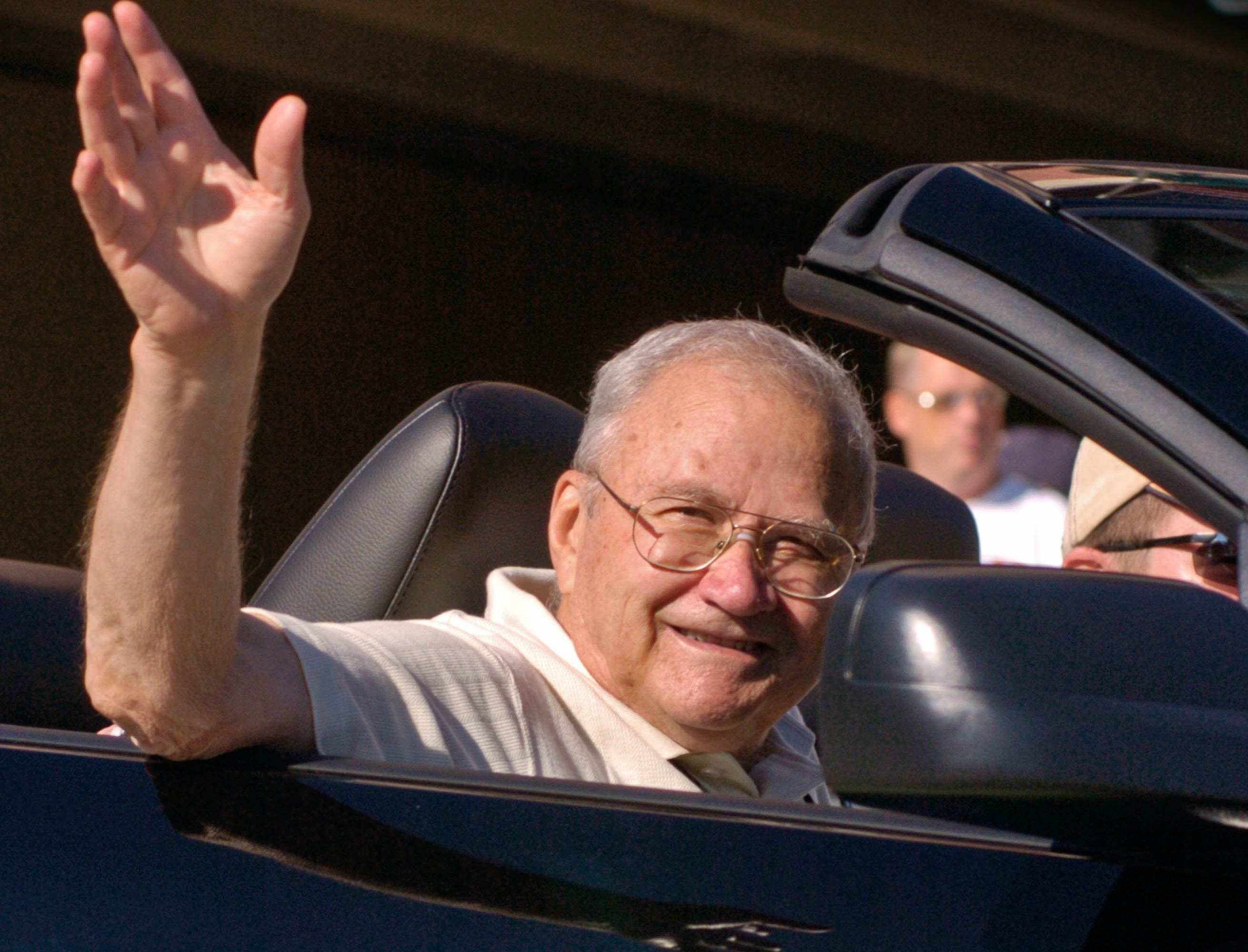 2006: Gagliardi waves  to crowds gathered in downtown South Bend, Ind., during an August 2006 parade to enshrine him and the other new inductees to the College Football Hall of Fame.