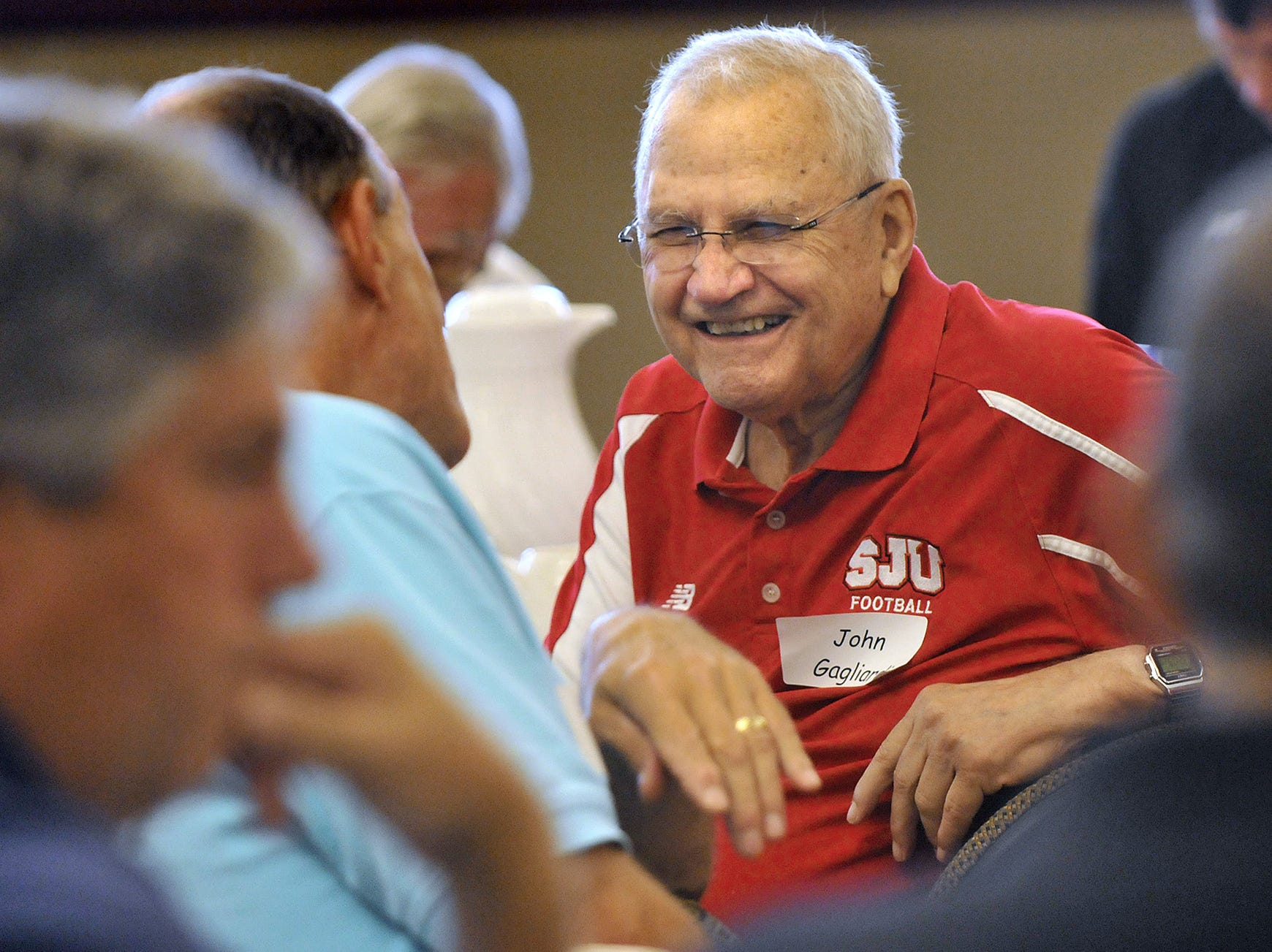 St. John's University head football coach John Gagliardi shared a laugh with an attendee at one of the traditional SJU football kickoff luncheons.