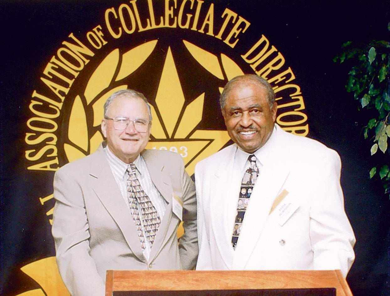 St. John's University's John Gagliardi (left) and Grambling State's Eddie Robinson shared the podium for a photo during a 1996 college football coaches association meeting. Gagliardi was, at the time, closing in on Robinson's win record.
