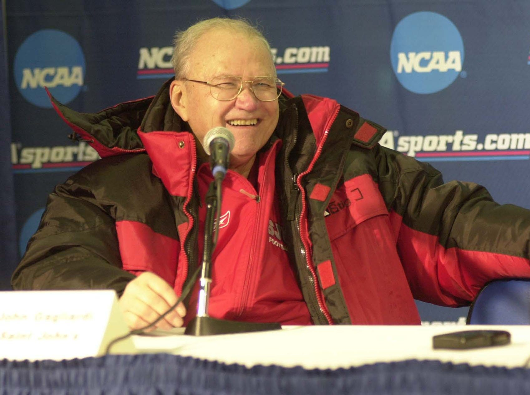 St. John's coach John Gagliardi allows himself a rare smile while talking with reporters at a press conference following the Johnnies' 24-6 win in the 2003 Stagg Bowl at Salem, Va.