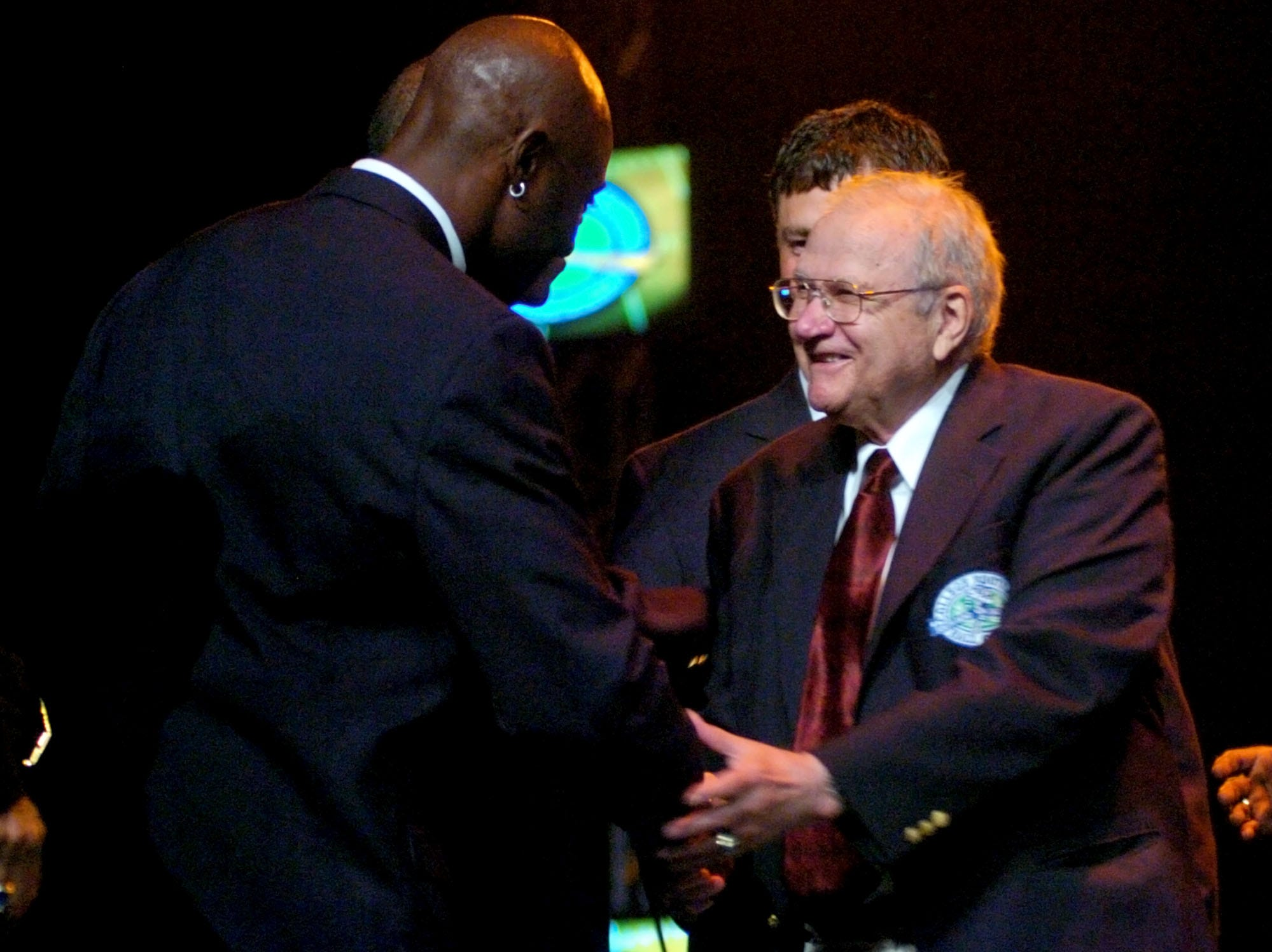 2006: College Football Hall of Fame inductees John Gagliardi and Jerry Rice congratulate each other after their enshrinement ceremony in South Bend, Ind. in August 2006.