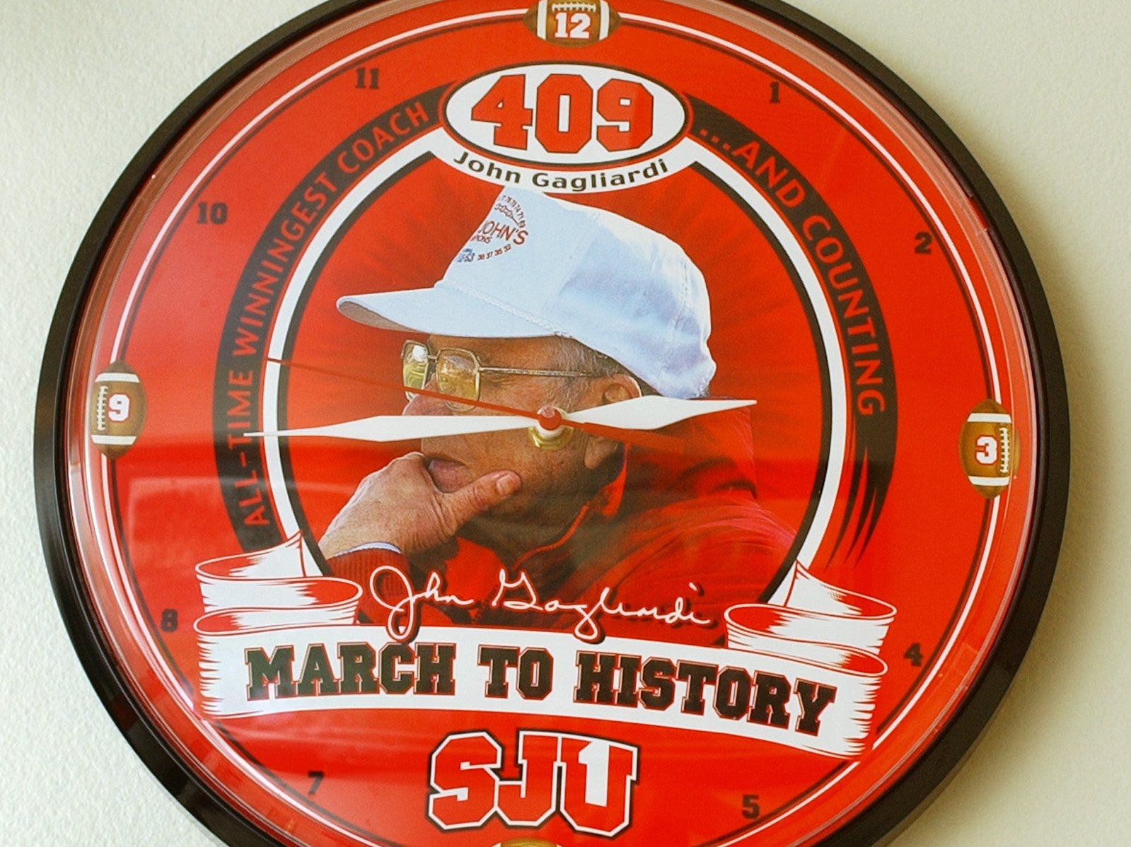 A clock commemorates John Gagliardi's 409th win, the victory making him history's most successful college football coach.