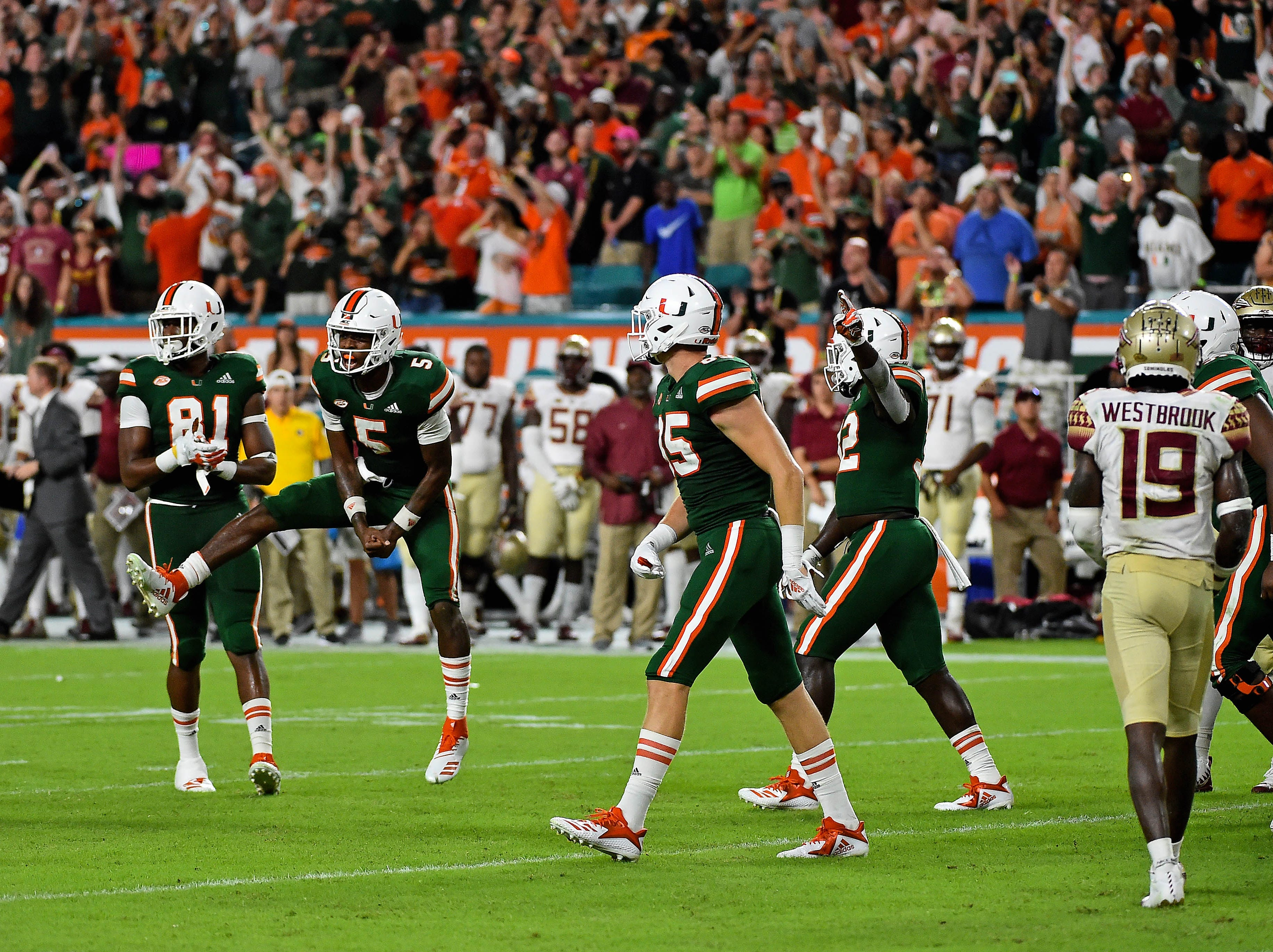 Oct 6, 2018; Miami Gardens, FL, USA; Miami Hurricanes quarterback N'Kosi Perry (5) celebrates after defeating the Florida State Seminoles at Hard Rock Stadium. Mandatory Credit: Jasen Vinlove-USA TODAY Sports