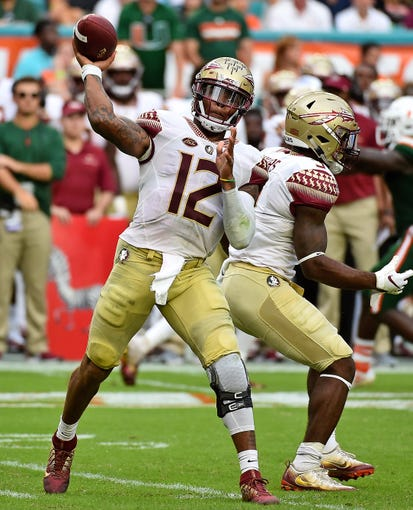 Oct 6, 2018; Miami Gardens, FL, USA; Florida State Seminoles quarterback Deondre Francois (12) attempts a pass against the Miami Hurricanes during the second half at Hard Rock Stadium. Mandatory Credit: Jasen Vinlove-USA TODAY Sports