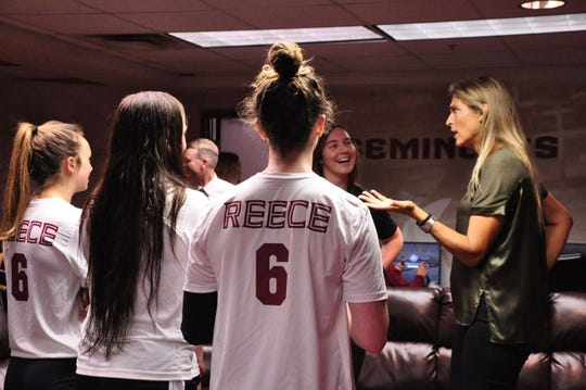 Gabby Reece talks to members of the Florida State volleyball team Sunday.