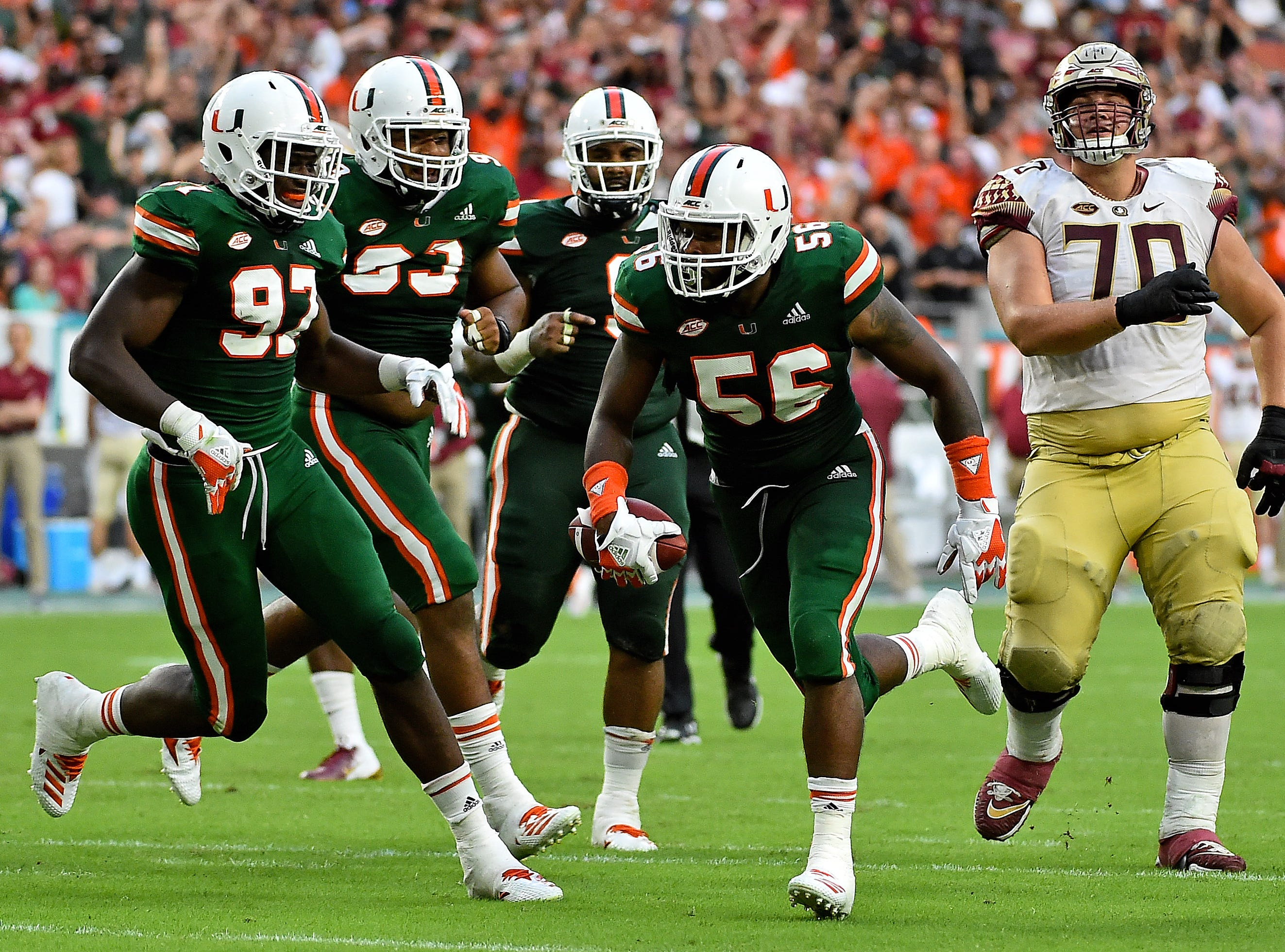 Oct 6, 2018; Miami Gardens, FL, USA; Miami Hurricanes linebacker Michael Pinckney (56) celebrates after intercepting a pass during the second half against the Florida State Seminoles at Hard Rock Stadium. Mandatory Credit: Jasen Vinlove-USA TODAY Sports