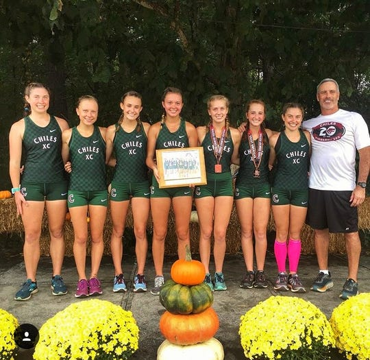 Chiles' girls cross country team celebrates a team win at the Great American Cross Country Festival in Cary, N.C. From left: Megan Churchill, Abby Schrobilgen, Lindsay James, Olivia Miller, Caitlin Wilkey, Emily Culley, Alyson Churchill and coach Mike Phillips.