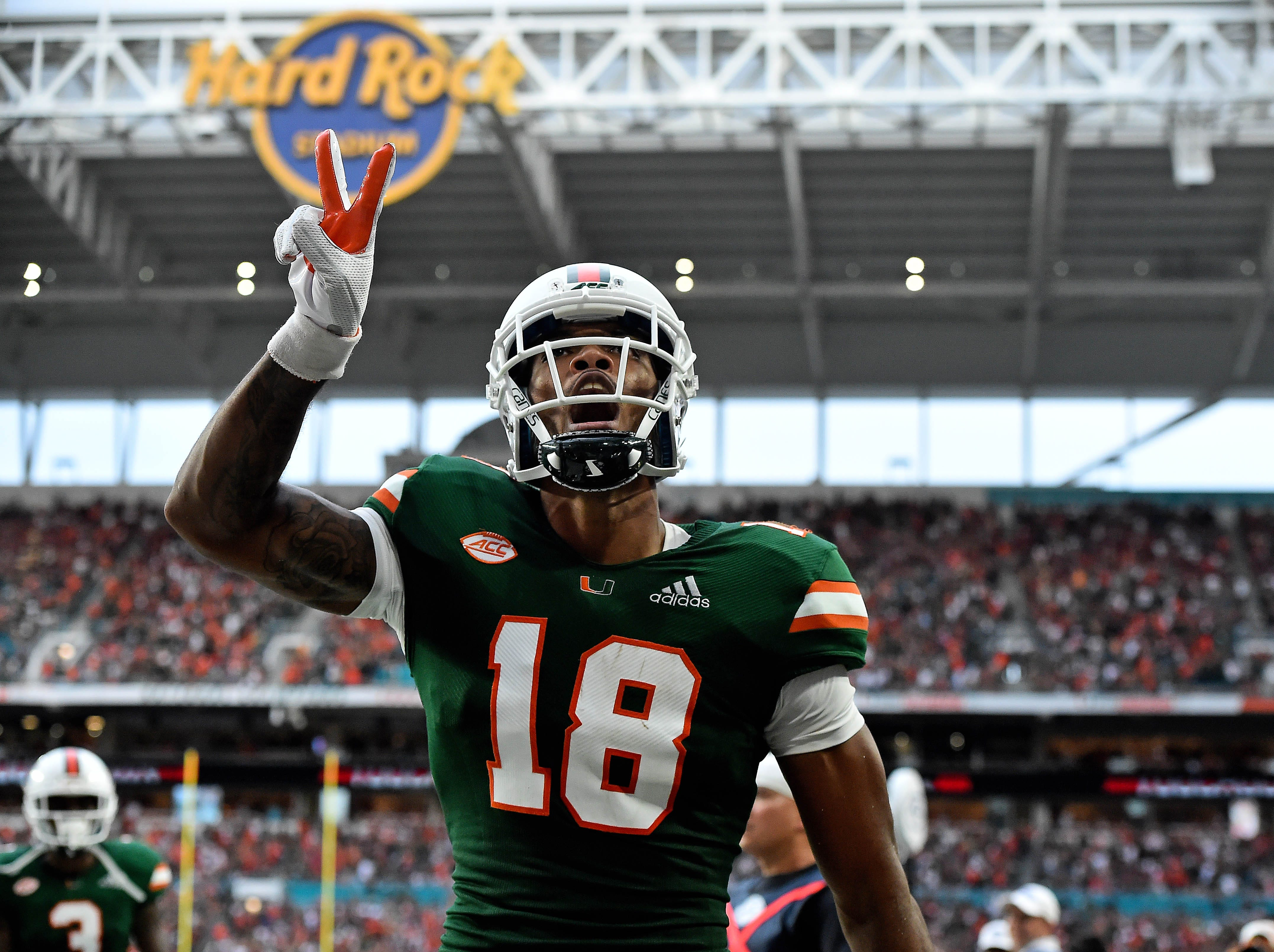 Oct 6, 2018; Miami Gardens, FL, USA; Miami Hurricanes wide receiver Lawrence Cager (18) celebrates after scoring a touchdown against the Florida State Seminoles during the second half at Hard Rock Stadium. Mandatory Credit: Jasen Vinlove-USA TODAY Sports