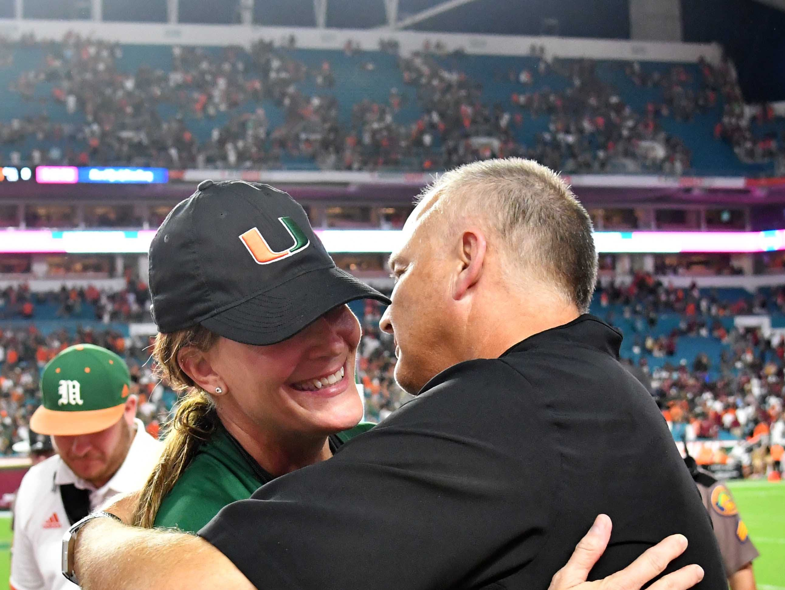Oct 6, 2018; Miami Gardens, FL, USA; Miami Hurricanes head coach Mark Richt hugs his wife Katharyn Francis after defeating Florida State Seminoles at Hard Rock Stadium. Mandatory Credit: Steve Mitchell-USA TODAY Sports