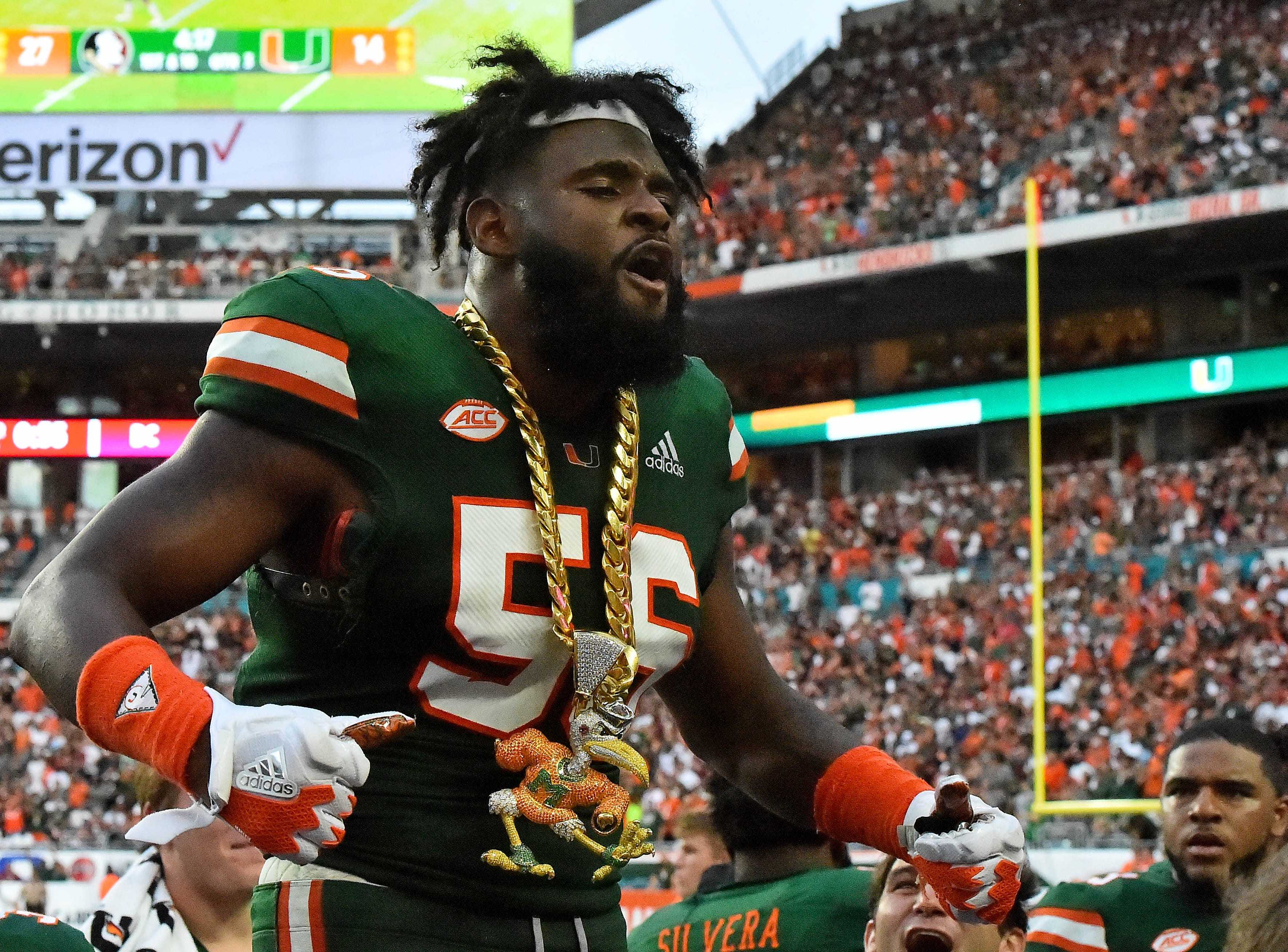 Oct 6, 2018; Miami Gardens, FL, USA; Miami Hurricanes linebacker Michael Pinckney (56) celebrates with the turn over chain after intercepting a pass during the second half against the Florida State Seminoles at Hard Rock Stadium. Mandatory Credit: Jasen Vinlove-USA TODAY Sports