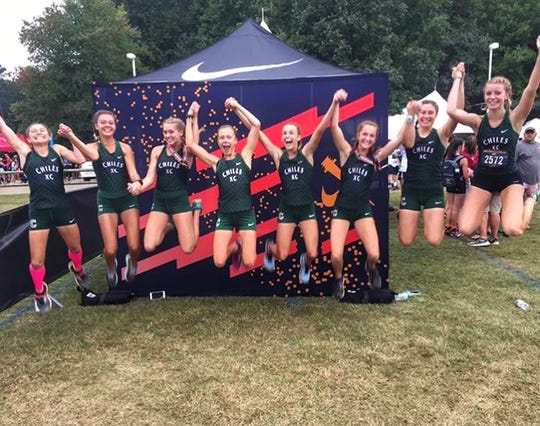 Chiles' girls cross country team celebrates a team win at the Great American Cross Country Festival in Cary, N.C.