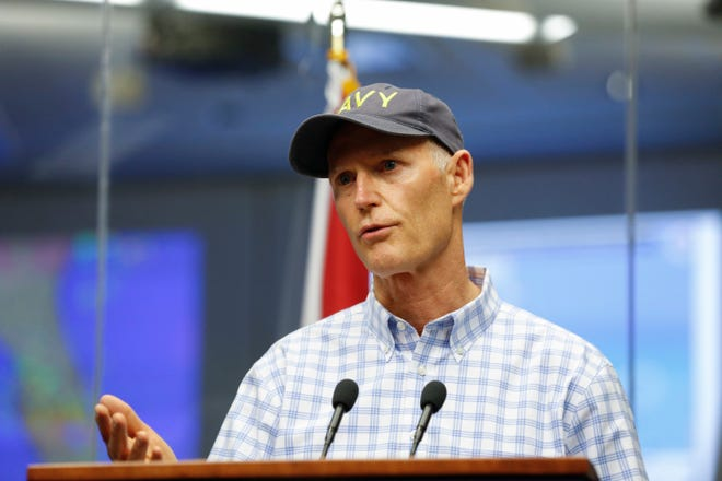 Gov. Rick Scott gives a briefing on Tropical Storm Michael at the Florida State Emergency Operations Center in Tallahassee Sunday, Oct. 7, 2018.