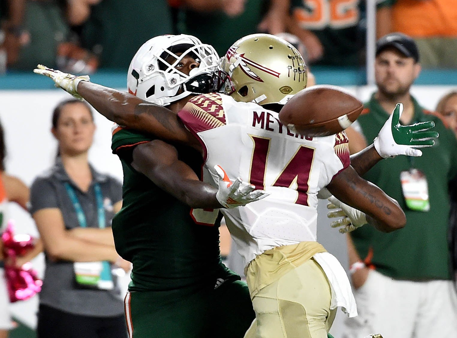 Oct 6, 2018; Miami Gardens, FL, USA; Miami Hurricanes wide receiver Dee Wiggins (8) is unable to make a catch as Florida State Seminoles defensive back Kyle Meyers (14) was called for pass interference during the second half at Hard Rock Stadium. Mandatory Credit: Steve Mitchell-USA TODAY Sports