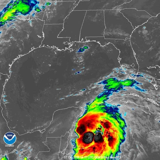 NOAA satellite image of a tropical depression forecast to strengthen into Hurricane Michael.