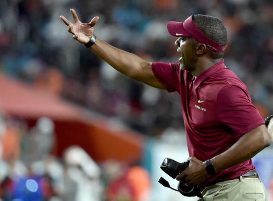 Oct 6, 2018; Miami Gardens, FL, USA; Florida State Seminoles head coach Willie Taggart reacts against the Miami Hurricanes during the second half at Hard Rock Stadium. Mandatory Credit: Steve Mitchell-USA TODAY Sports