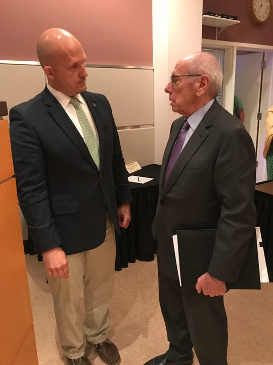 Port St. Lucie Mayor Greg Oravec confers with Chris Kallivokas of RER Ventures about his pending purchase of the former Vaccine & Gene Therapy Institute Florida (VGTI) building.