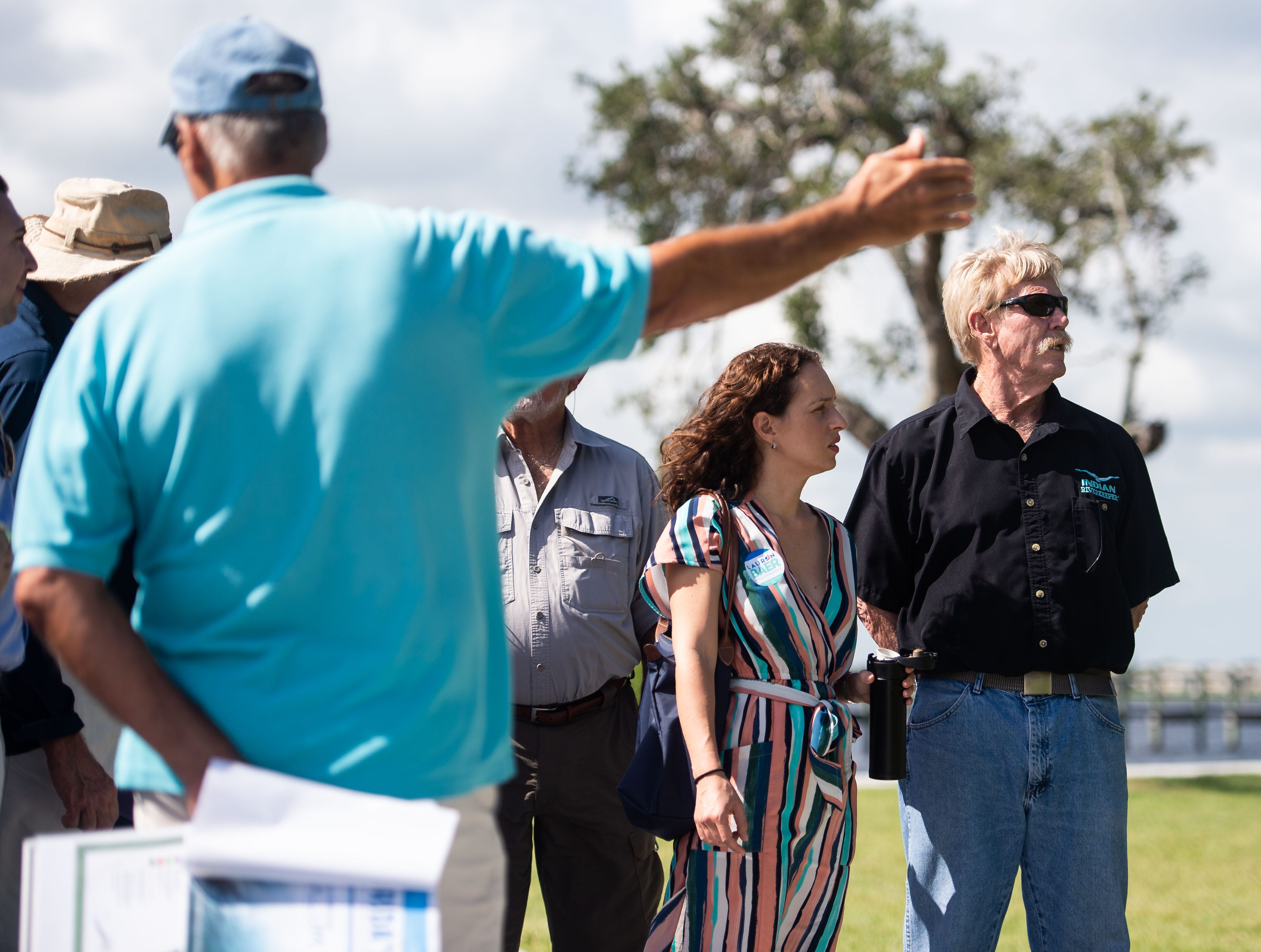 Democratic candidate Lauren Baer (center), who is challenging incumbent U.S. Rep. Brian Mast for his Dist. 18 seat, prepares to meet up with gubernatorial candidate and Tallahassee Mayor Andrew Gillum for a boat tour regarding the blue-green algae crisis on the St. Lucie River on Sunday, Oct. 7, 2018, out of Shepard Park in Stuart.