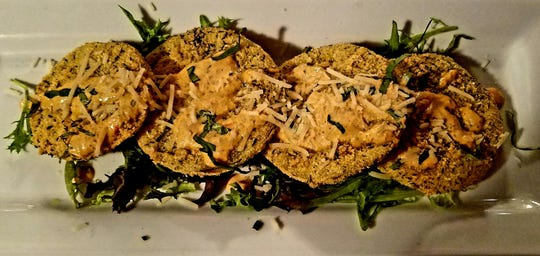 East Ocean Bistro's fried green tomatoes with Parmesan-infused breading and a cherry pepper remoulade.