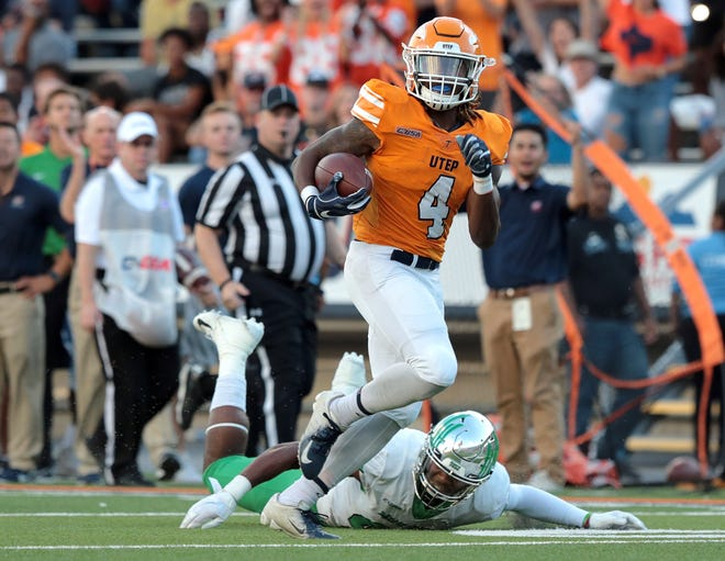 UTEP wide receiver Quardraiz Wadley catches a touchdown pass against UNT Saturday at the Sun Bowl.