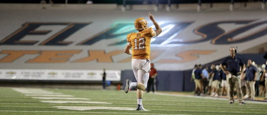 UTEP's Ryan Metz celebrates a touchdown run.