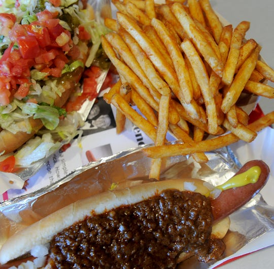 A Chili Dog, Polish Dog and French fries are shown at Pink's Hot Dogs at the Camarillo Premium Outlets.