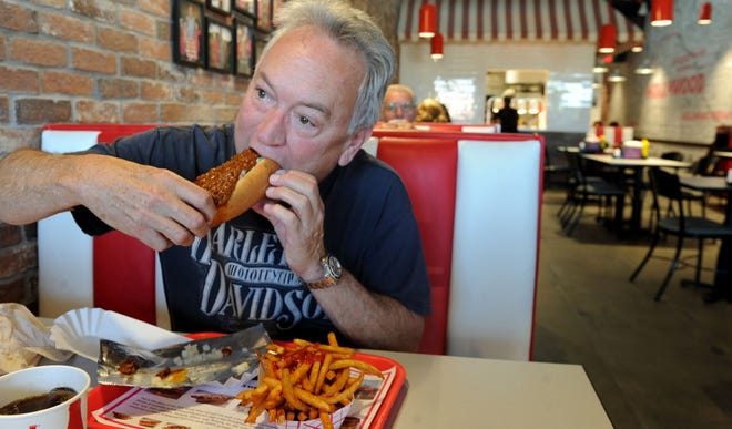 Bill Nichols eats a Chili Dog at Pink's Hot Dogs at the Camarillo Premium Outlets.