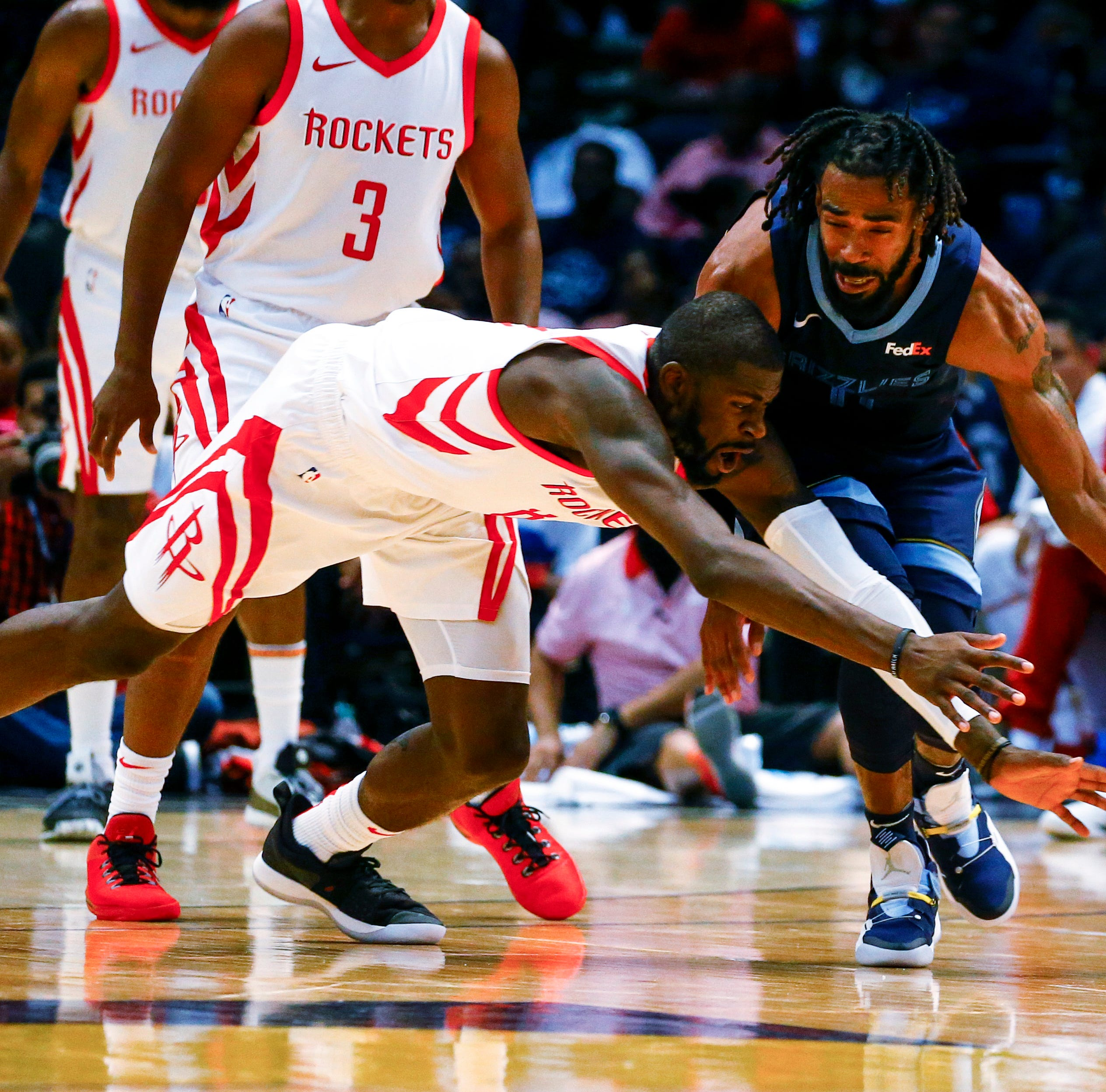 Former Ventura High and Ventura College star James Ennis tries to steal the ball from Grizzlies guard Mike Conley during a Rockets preseason game.