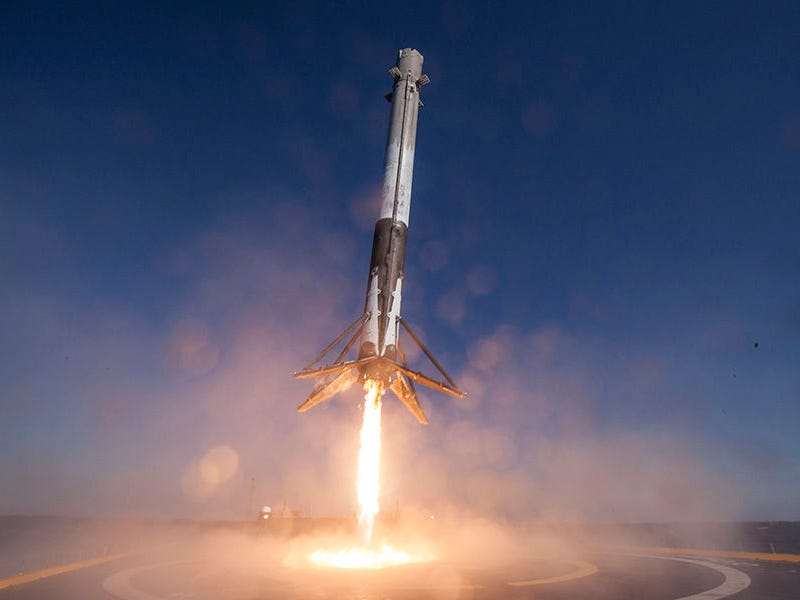 The first stage of a SpaceX Falcon 9 rocket lands after a launch during a prior mission.