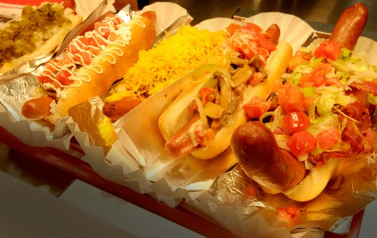 The Naked, Guadalajara, Chili Cheese, America the Beautiful, and the Italian hot dogs from Pink's Hot Dogs at the Camarillo Premium Outlets are displayed.