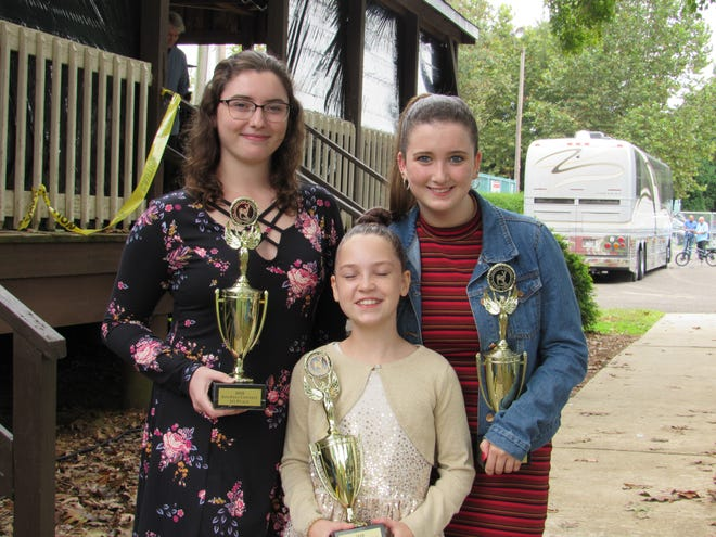 The final round of the Deerfield Township Harvest Festival SingFest was held on Oct. 6. The winners are: Anna Masusock (center) of Wenonah for the age 4 to 12 category; Reagan Keene (right) of Huntingdon Valley, Pa., for the age 13 to 18 category; and Nikki Garofalo of Wenonah for the age 19 and older category. Each finalist received a SingFest certificate and a trophy. Each winner also received a $100 cash prize.