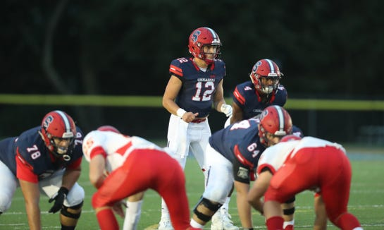 Stepinac quarterback Joey Carino (12) calls the play during their 13-7 loss to Chaminade in CHSFL football action at Stepinac High School in White Plains on Saturday, October 6, 2018.
