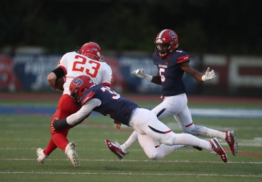 Stepinac's Kevin McKenna (32) tackles Chaminade's Beandan Janosko (23) dirubg their 13-7 loss to Chaminade in CHSFL football action at Stepinac High School in White Plains on Saturday, October 6, 2018.