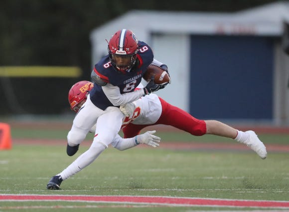 Stepinac's Shawn Harris (6) looks to break a tackle during their 13-7 loss to Chaminade in CHSFL football action at Stepinac High School in White Plains on Saturday, October 6, 2018.