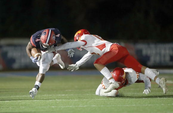 Stepinac's Malik Grant (4) breaks a tackle during their 13-7 loss to Chaminade in CHSFL football action at Stepinac High School in White Plains on Saturday, October 6, 2018.