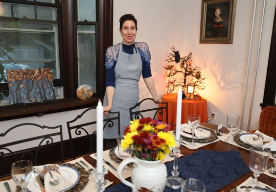 Nicole Brake is pictured in the dining room for the Harvest Moon Dinner, hosted by her Broomstick Sweeties, a underground supper club in White Plains, Oct. 6, 2018.