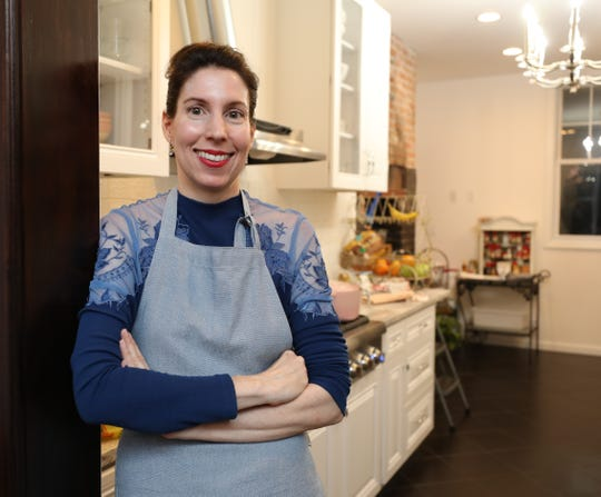 Nicole Brake is pictured in the kitchen for the Harvest Moon Dinner, hosted by her Broomstick Sweeties, a underground supper club in White Plains, Oct. 6, 2018.