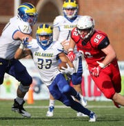 Delaware running back DeJoun Lee (33) gains ground in the second quarter of the Hens' 43-28 win at Richmond Saturday. Richmond's Colby Ritten follows.