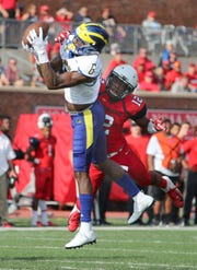 Delaware receiver Jamie Jarmon sets up a Blue Hen touchdown with a long reception from Joe Walker as Richmond's Markus Vinson defends in the second quarter at Richmond Saturday.
