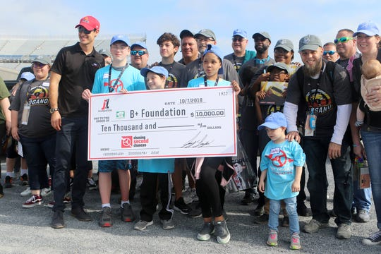 Joey Logano takes time before the Monster Energy NASCAR Cup Series playoff race Sunday to donate $10,000 to the B+ Foundation of Delaware and to talk with the eight B+ Heroes (kids with cancer) and their family members.