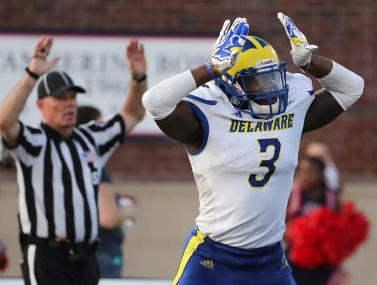 Delaware's K.C. Hinton reacts after his tackle on a punt return in the fourth quarter of the Hens' 43-28 win at Richmond Saturday.