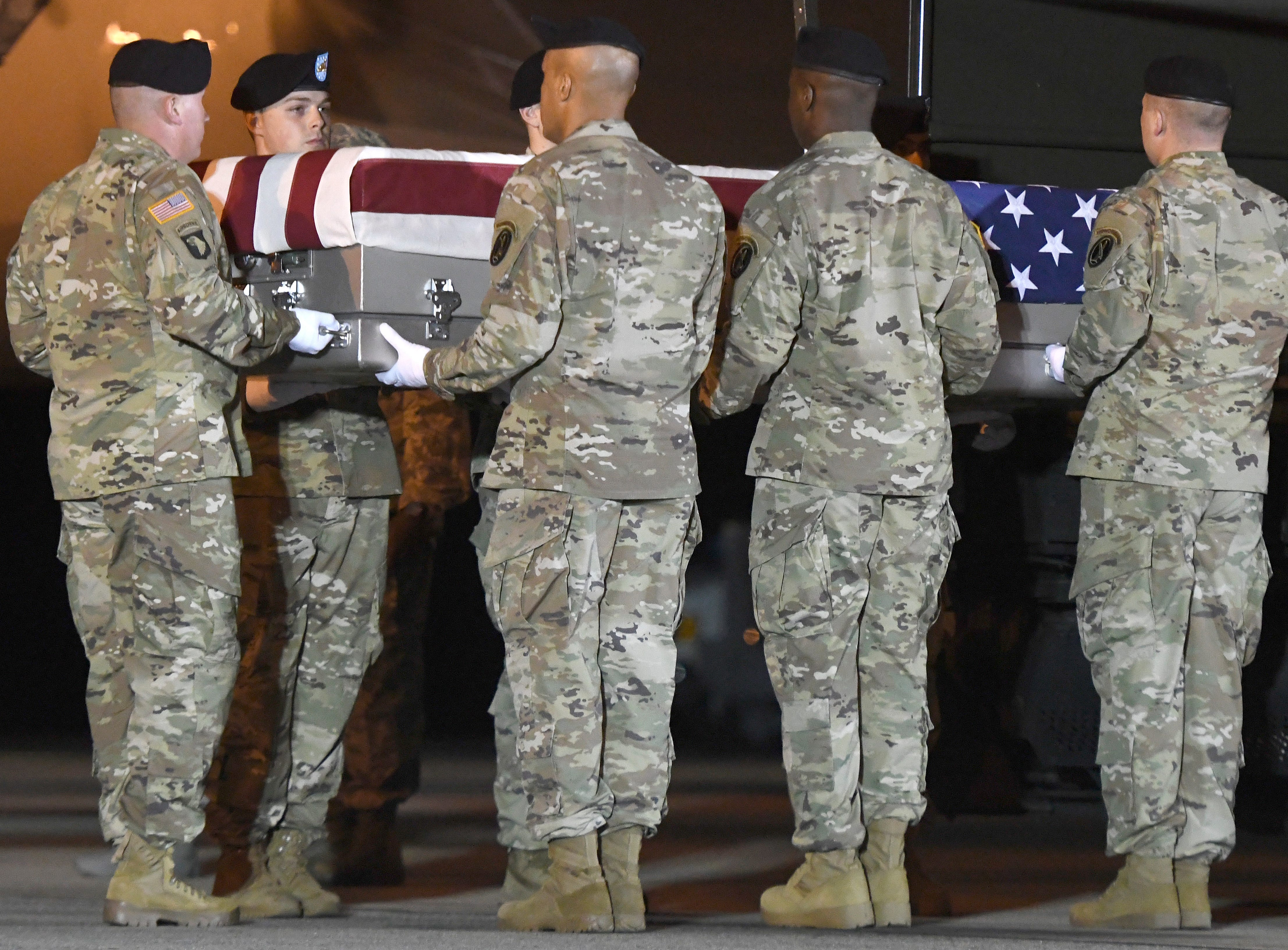 An Army carry team moves a transfer case containing the remains of Sgt. James A. Slape at Dover Air Force Base, Del., on Saturday, Oct. 6, 2018. According to the Department of Defense, Slape, 23, of Morehead City, N.C., died Oct. 4, 2018 in Helmand province, Afghanistan of injuries sustained from an improvised explosive device.