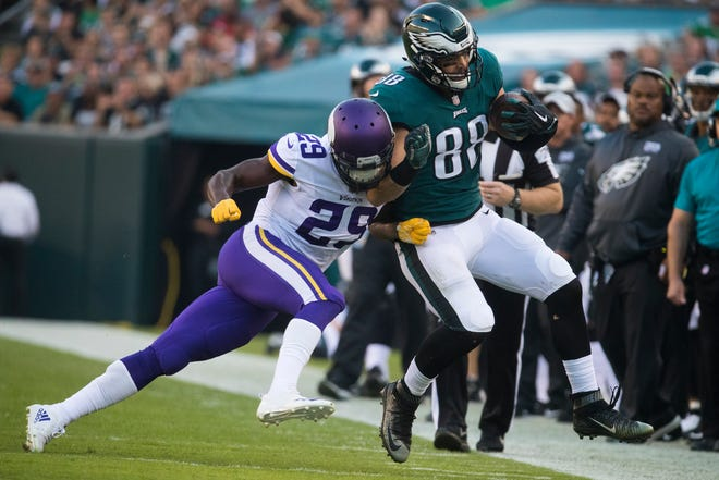 Tight end Dallas Goedert (88), the Eagles' second-round pick last spring, is knocked out of bounds by Minnesota's Xavier Rhodes (29) during a recent game at Lincoln Financial Field.