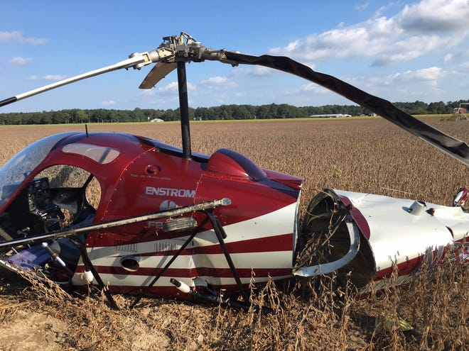 A helicopter crash-landed in a soybean field near Bridgeville Sunday.