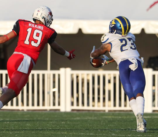 Delaware's Nasir Adderley (right) makes a fingertip catch for an interception on a pass meant for Richmond's Tyler Wilkins in the fourth quarter of the Hens' 43-28 win at Richmond Oct. 6.