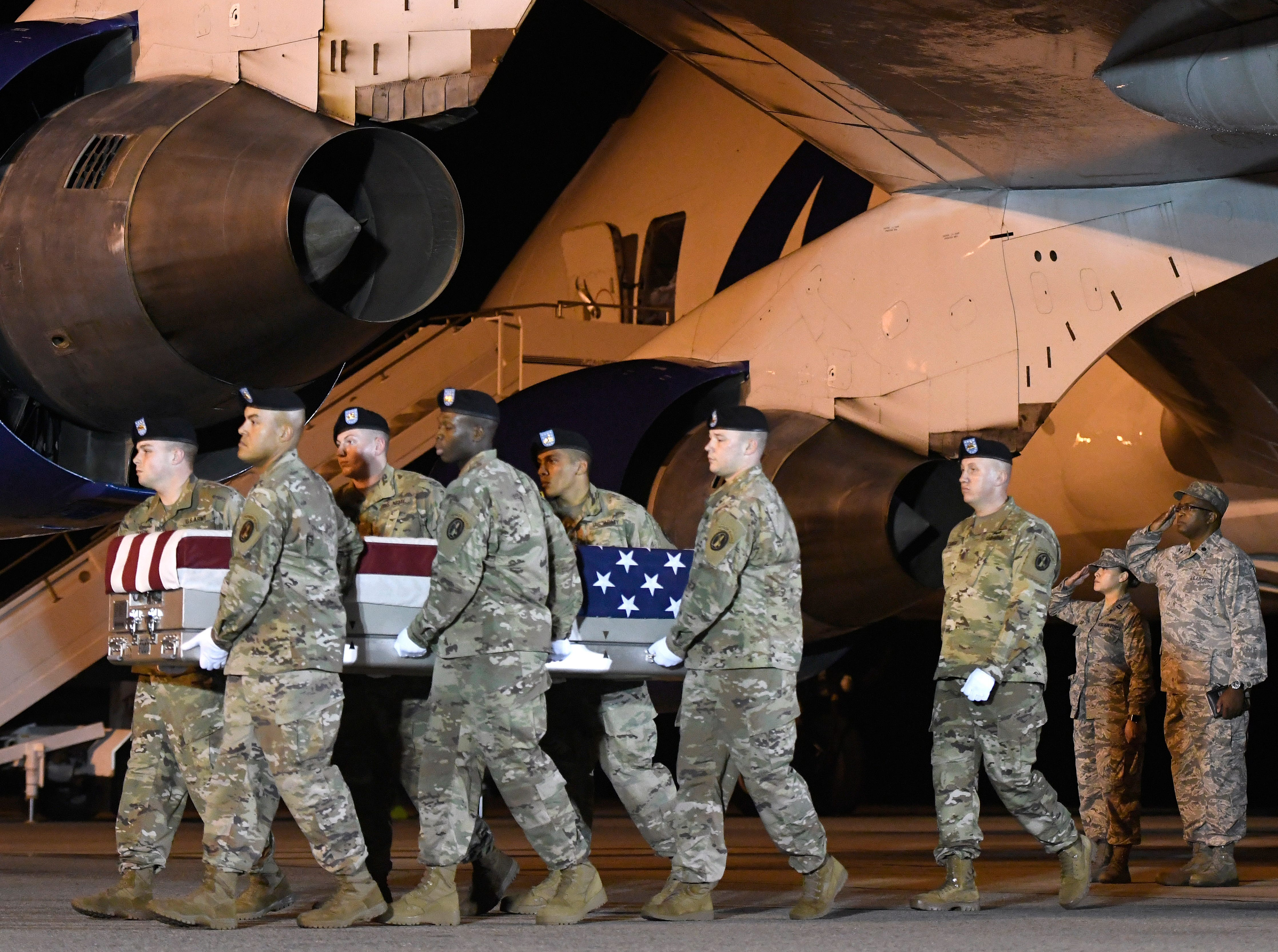 An Army carry team moves a transfer case containing the remains of Sgt. James A. Slape at Dover Air Force Base, Del., on Saturday, Oct. 6, 2018. According to the Department of Defense, Slape, 23, of Morehead City, N.C., died Oct. 4, 2018 in Helmand province, Afghanistan, of injuries sustained from an improvised explosive device.